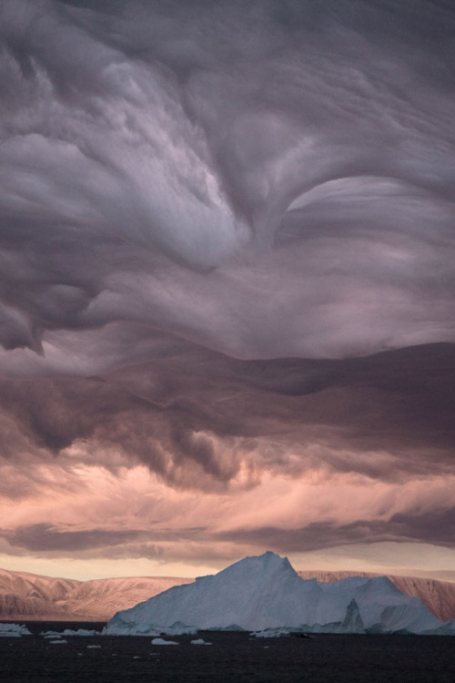Amazing photo. The clouds look like upside-down waves to me.