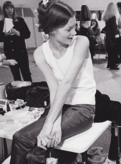 Kate Moss backstage at a Paris fashion presentation, 1991