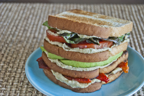 Roasted Red Pepper Avocado Club Sandwich with White Bean Hummus Source: Vegetarian Sandwiches by Paulette Mitchell It's Kitchen Klutzes of America Day and to celebrate I present the one food that anyone can cook, especially the kitchen klutzes like me who are prone to burning food under the broiler: roasted red peppers. The peppers are roasted until the skin is blackened (and smells like pizza!), turning as necessary to broil each side. Seal them for 10 minutes in a plastic bag, allowing the peppers to steam and the skin to fully separate from the flesh of the pepper. Discard the skin and remove the seeds and ribs and you'll never want to eat jarred roasted red peppers ever again.
