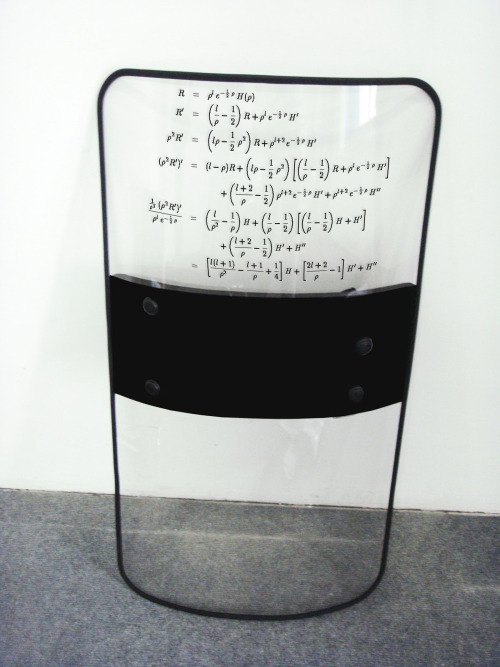 thejogging:  RIOT SHIELD WITH COMPLEX MATHEMATICAL EQUATION USED IN FINANCIAL MARKETS CONTAINING DERIVATIVE INVESTMENT INSTRUMENTS, 2012 Sculpture ~  I like this because it's thought-provoking, but in an unexpected way. They're always talked about, but I've never actually seen one of the 'complex mathematical equations' used in the financial markets before. And sure, it looks complicated* - and I've no idea what it means, or what any of the four variables R, p, l and H stand for - but it looks quite normal compared to other mathematical equations I've seen in other (actual) branches of science. So in appearance at least it's not really that mystical, in fact it's as familiar as anything else from physics or pure mathematics - probably the plastic that makes up the riot shield itself has a long and complicated-looking chemical equation describing its production. Which points to a certain element of anti-intellectualism in laying the blame for the financial crash on 'exotic instruments' and these incomprehensible mathematics - I'm sure on a practical level there's a lot of truth to that, it's difficult to manage and assess what you can't understand, but it's when it's taken from that kind of insider critique to a generalised statement of criticism that I wonder. I guess you could say Oppenheimer and those working on the atomic bomb did understand what they were doing in a technical and physical sense, although they were more ambivalent about its human and political consequences, and these mad wizards of financial trading are more blindly destructive, in a less horrendous but perhaps more socially pervasive manner; but I'm suspicious of the idea that we should be fearful of science and knowledge itself rather than the means of controlling and implementing such (although, to go a little Foucauldian, those two can't be wholly separated). Or maybe it's just that economics is, and always will be, the 'dismal science' - although ironically that name** was given, not simply because it attempts to elevate complicated empirical judgements in social science to determinative mathematical theory, but because it was felt that it predicted the unsustainability of human population growth. Which prediction, by Malthus, was rendered null by technological advancement - at least until now, where the return of environmental pressures have undermined not only the economic ideal of limitless economic growth, but also brought into question the capacity of the planet to sustain the associated and interlinked human population growth. I don't think it's right or even possible that mathematical equations will solely decide the limits of human aspiration, but a new political economy will have to be formed for a sustainable world, and the revolution will include complicated mathematics. *complex, as I understand it, is simply to mean containing multiple parts, while complicated more accurately (and subjectively) implies difficulty of understanding **apparently as opposed to 'The Gay Science', which makes me feel bad for not having read Nietzsche yet.
