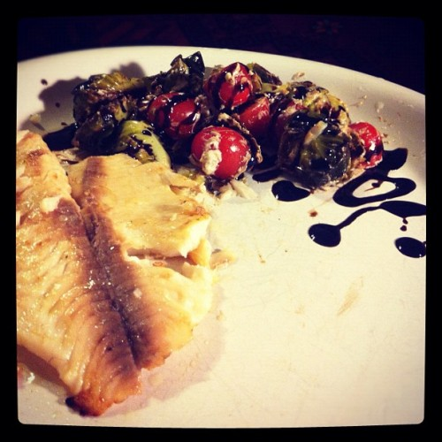 Tilapia and balsamic glazed brussels sprouts with tomatoes and goat cheese. I finally used my kitchen to cook. (Taken with Instagram)