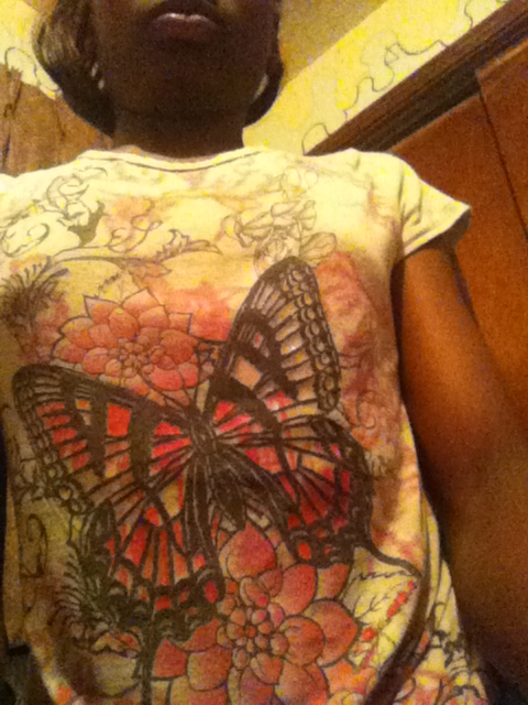 A butterfly shirt that is pink -n- glittery