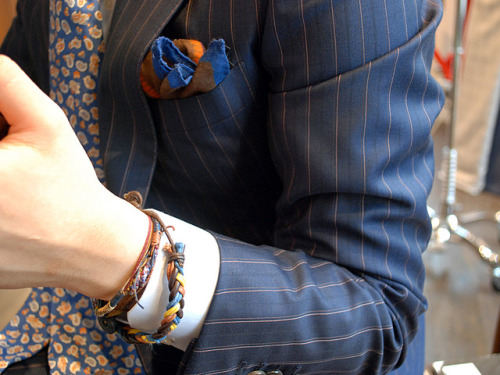acuratedman:  I love the color in this suit and the tie and pocket square pull them out very well.