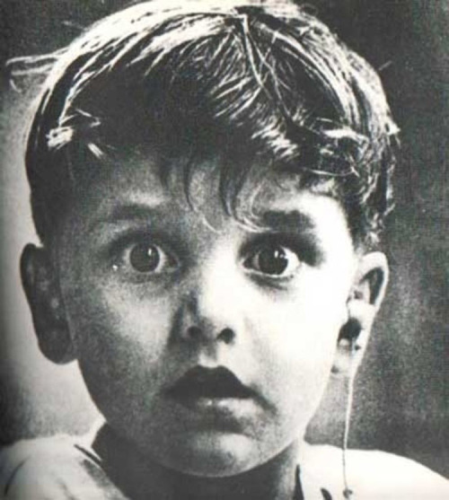 """Harold Whittles hears for the first time ever after a doctor places an earpiece in his left ear."""