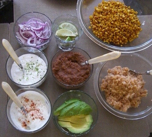 "ozvegan:  I made do-it-yourself-burritos and spicy roasted corn with a ""cheesy/mayo"" dressing (my own take on the popular Mexican Grilled Corn Street Food).For the burritos I toasted some Food For Life organic corn tortillas, heated up some Amy's Traditional refried beans, sliced up red onions, cut up some avocado, quartered some lime slices, cooked up some simplified Mexican red rice (read: brown rice cooked w a bit of tomato paste and fresh, chopped garlic), and jazzed up some vegan sour cream with lime juice and zest.For the corn I roasted two cans of organic corn on a baking sheet with some salt and Earth Balance at 400 degrees for about 30 minutes mixing every 10 or so to make sure the kernels browned evenly.  Then I sprinkled it with smoked paprika and cayenne pepper.  I served it with a dressing to dollop on.  The dressing was 1/2 cup of vegan sour cream, 1 tablespoon of Veganaise, the juice of 1/2 a lime, then sprinkled with a bit more paprika (for looks of course)."
