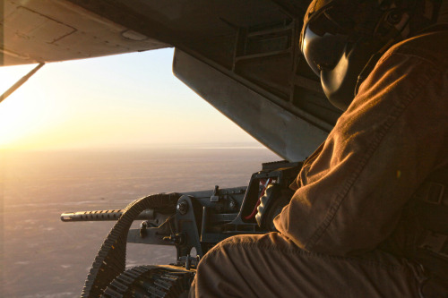 Staff Sgt. Hugo Paniagua, an aerial observer with Marine Heavy Helicopter Squadron 362 and native of Brooklyn, N.Y., scans the surrounding area for activity in Helmand province, Afghanistan, June 4. Helicopters from the squadron transported ground units to conduct drug raids. Read more: http://www.dvidshub.net/image/597303/ugly-angels-deliver-devil-dogs#.T9cGPr9XAVk#ixzz1xZHt3e5u