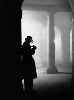 m3zzaluna:  unknown photographer, silhouette of man lighting pipe, london, england, december 23, 1935