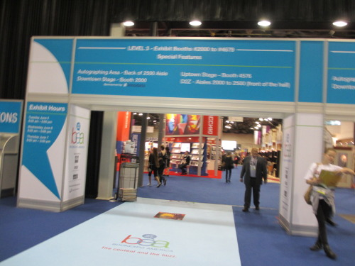 Book Expo Until this year, Book Expo America (BEA) has been an industry only convention. I have been lucky enough to get to go through my jobs and school, but I realize that if I had not been involved in the book industry I would have never known about BEA. This year they opened the doors to the public and I am not sure how many people found out. Just in case they do it again I thought it might be good to let you guys know what it is about. FREE BOOKS! (and networking with the book industry…) The publishers and authors that attend BEA usually promote a ton of books and hand out galley copies. Most of the time the authors are there to sign them. As you can see below I met a ton of cool people:  Tim Gunn                                    Chris Colfer  Jonathan Mayberry                                 Erin Morgenstern  Bruce DeSilva                                          Kenneth Wishnia  Jeff Kinney                                    Chris Giarusso  Libba Bray                                                  Stacy London Most of the books I brought home:  The convention is still geared toward professionals and you will see a ton of people sitting down to chat about deals and promoting. Many of the vendors will be for products that help booksellers and libraries, but you can still have a great time as a non-professional. There are a few lessons I would like to leave you with to keep in mind for Book Expo 2013: 1. Bring something with wheels to haul your books home. Your back will thank you.2. Bring your own food. the Jacob Javits Center Food Court is expensive.3. Get there early. A lot of vendors run out of free stuff in the afternoon.4. Authors are just as excited as you are. Most of them are really nice and humble people. Treat them right. :)5. Have Fun!
