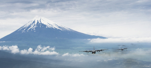 Photo of the day: Coming 'round the mountainA formation of U.S. Air Force C-130 Hercules cargo aircraft fly past Mount Fuji, the tallest mountain in Japan, on June 5 after completing a Samurai Surge training mission near a U.S. military base. On clear days, the snow-capped summit of the 12,388-foot active stratovolcano is visible from Tokyo, which lies only 62 miles northeast of the mountain.