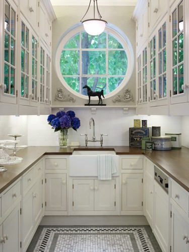 thefoodogatemyhomework:  Beautiful kitchen area by the kitchen guy in Chicago, Mick DeGiulio. Wonderful big round window above the sink, and lovely soft palette enhances the beautiful tile floor. And I love a little butcher block countertop.
