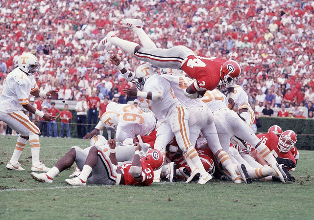 Georgia RB Herschel Walker leaps a pile of Tennessee defenders for a touchdown during a 1981 game. (Ronald C. Modra/SI) GALLERY: Rare Photos of Herschel WalkerSTAPLES: UGA's strict drug policy puts program at disadvantage