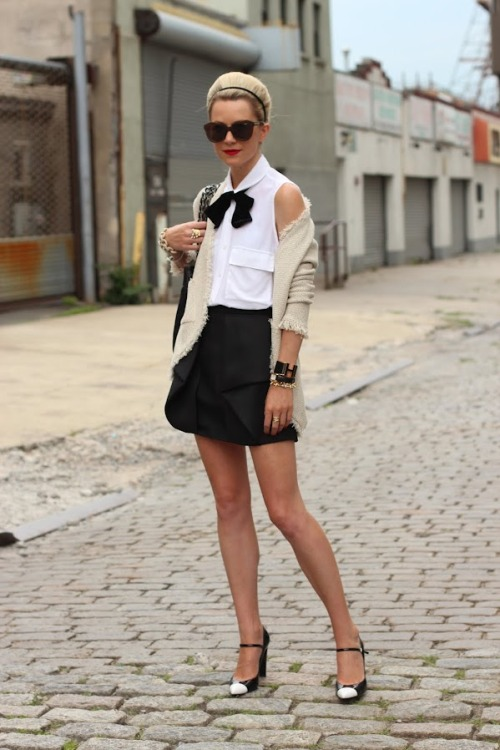 what-do-i-wear:  Skirt: Tibi. Top: Equipment. Shoes: Stuart Weitzman. Purse: Chanel. Sunglasses: Karen Walker 'Number One'. Lips: MAC 'Ruby Woo'. Nails: Essie 'Lollipop'. Bow: ASOS. Jewelry: David Yurman, Kate Spade, Jcrew, Stella&Dot, Pomelatto, YSL. Cardi: Zara (image: atlantic-pacific)  I love her.