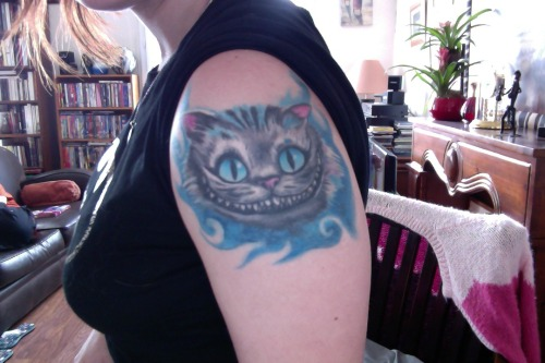 Here is my tattoo of the Cheshire cat of the movie Alice in wonderland by Tim Burton. It represents a part of me now, it is maybe stupid but when I made it I felt different and stronger. Every time we change skin, and it is magnificent. Thanks to Maxyne of La Maison des Tanneurs in Paris.