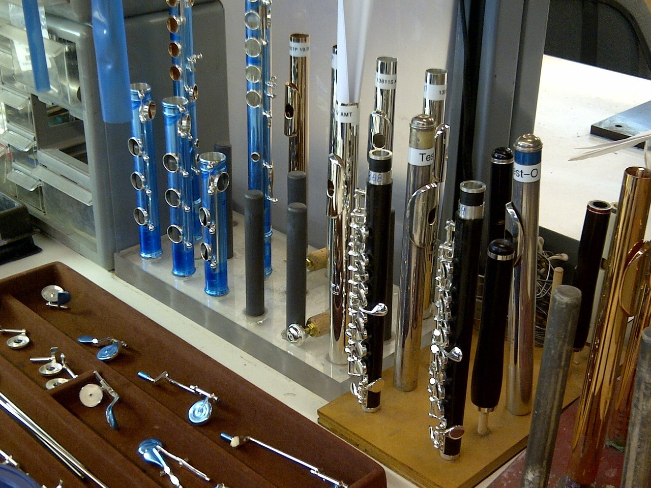 "One of our custom flute builder's work stations.  A couple of ""tester"" headjoints here to use with the flutes and piccolos as they're finished."