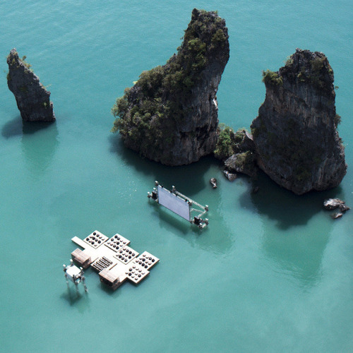 Image via Honestly WTF. What dreams are made of.  Film festival in Yao Noi, Thailand.  This was put together by Tilda Swinton and director, Apichatpong Weerasethakul.  Lucky attendees were boated to the floating theatre where they enjoyed the original Peter Pan film (1924). That Song In My Head: O.N.E. - Yeasayer