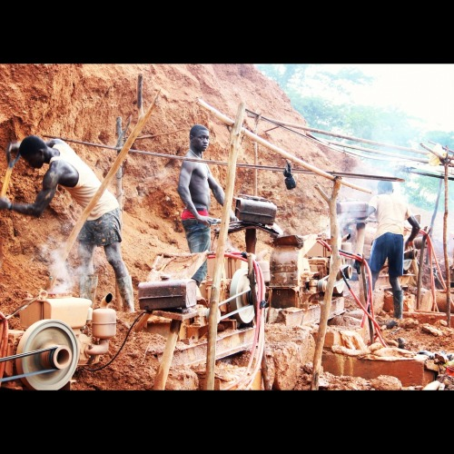 futureisopen:  Miners at a Galamsey in Dadiaso, Ghana put soil into machines, beginning the process to extract gold. The environmental and social impact of artisanal mining sites in Western Ghana could be better assessed if monitored by coalitions including civil society, private sector and government.   Look at them. Barely clothed, laboring in the sun for our own luxury. They may get paid, but in my mind, they're slaves. Slaves to us, to their lives, to their situations. How sad.
