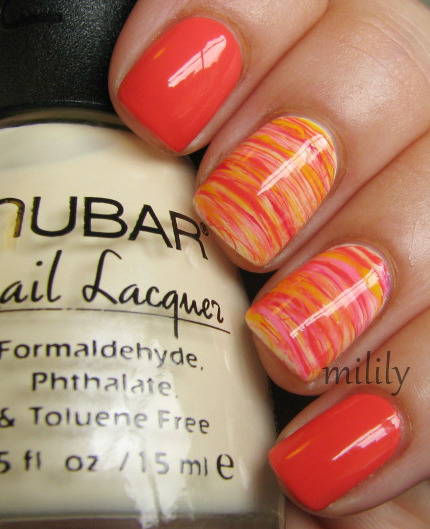 mililypolish:  Orange franken with accent nails (I'm still trying to figure out what to call these).   ~Polishes used for accent nails: Nubar Yellow Primrose (base), Orange franken, Essie Watermelon, Color Club Yum Gum, and Color Club Almost Famous.