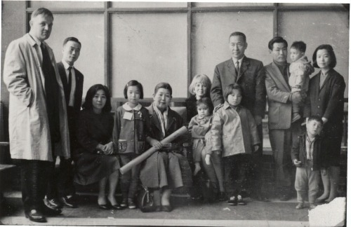 "This is was taken the day I left Kimpo Airport in Seoul in March, 1966. I'm the one with the jacket. I look fat because I had several layers of clothing on underneath. The man standing behind me was the director of the orphanage. Just before he nudged me toward the plane, he told me, ""Don't tell them who you really are until you're old enough to take care of yourself.""   - Deann Borshay Liem, filmmaker and curator of this blog (www.mufilms.org)"