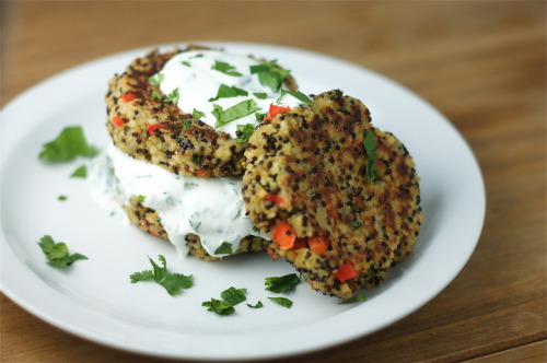 theboredvegetarian:  Spicy Quinoa Cakes with Lime & Cilantro Sour CreamI've been obsessing over making quinoa cakes since I had them at Lodge in Williamsburg a few weeks back…2 cups cooked Quinoa (I used a combo of black and white quinoa)3 Eggs, lightly beaten 1 Jalapeno, seeds removed, minced1 clove Garlic, minced1 small Red Bell Pepper, chopped in to small pieces1/2 cup chopped Cilantro 3/4 cup Bread Crumbs (plus more if needed)Salt to tasteOlive oil1 small container Sour Cream1 1/2 Limes In a bowl, season quinoa with salt.  Add garlic, red pepper, 1/4 cup of cilantro, jalapeno to the quinoa and mix together.  Add eggs and toss together.  Add bread crumbs and mix together.  Let sit for a few minutes until the liquid is absorbed (you're going to form patties, so add more breadcrumbs if it's too soft, or a little bit of water if too dry).  Form into patties with your hands (whichever size you like, but make sure they're not too thick).  Heat olive oil in a saute pan.  Cook each side of the patties on low/medium heat until brown, carefully flipping over.  For the sour cream, combine remaining cilantro and juice from the limes and mix together.  Top quinoa cakes with lime & cilantro sour cream and serve.