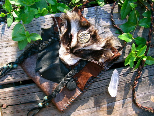 Raccoon Forest Companion Bag, *here*  This is the first in a series of celtic companion bags, the lovely face was bought from thegreenwolf on etsy (and on tumblr). This Bag has also been hand-stitched as is all my other bags.