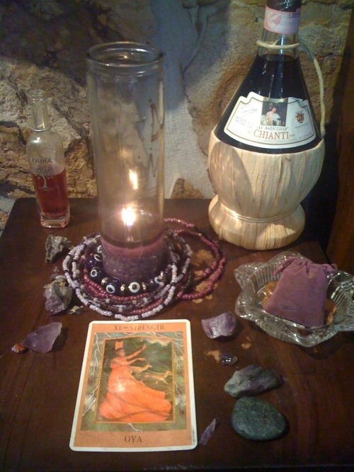 sacredwell:  Our altar for Oya is always well fed.  The customers love to slip her little offerings!