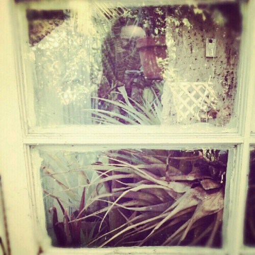 I like to be #outside in my #backyard #greenhouse  #reflection #selfportrait  (Taken with Instagram)