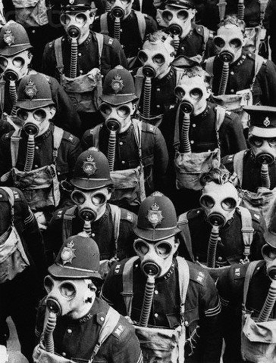 itsjohnsen:  London policemen wear gas masks for a training drill, 1937. Bettmann Collection