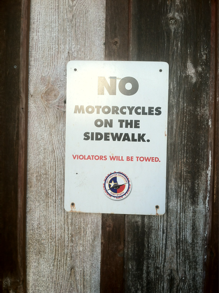 No motorcycles on the sidewalk