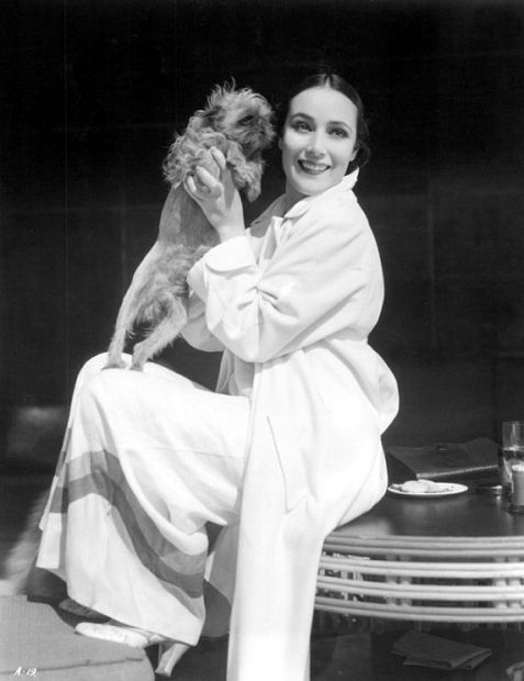 Dolores del Río & her Brussels Griffon.  (August 3, 1905 – April 11,1983) Dolores del Río was a Mexican film actress. She was a star of Hollywood films during the silent era and in the Golden age of Hollywood. She later became a prominent actress in Mexican films. She was considered one of the most beautiful actresses of her time and was the first Latin American movie star to have international success. In the silent film era, del Río was considered a female counterpart to Rudolph Valentino. FIERCE on oh so many levels!!! Her career flourished until the end of the silent era, with successful films such as Resurrection (1927), Ramona (1928) and Evangeline (1929). With the arrival of the talkies in the early thirties, Del Río's exotic image was radically changed. She scored successes with Bird of Paradise (1932), Flying Down to Rio (1933), Madame Du Barry, Wonder Bar(1934) and Journey into Fear (1942). Del Río then returned to Mexico. Under the guidance of Emilio Fernández, at the age of 37, Del Río became the most important star of the Golden age of Mexican cinema. Her masterpiece is the legendary film Maria Candelaria (1943).