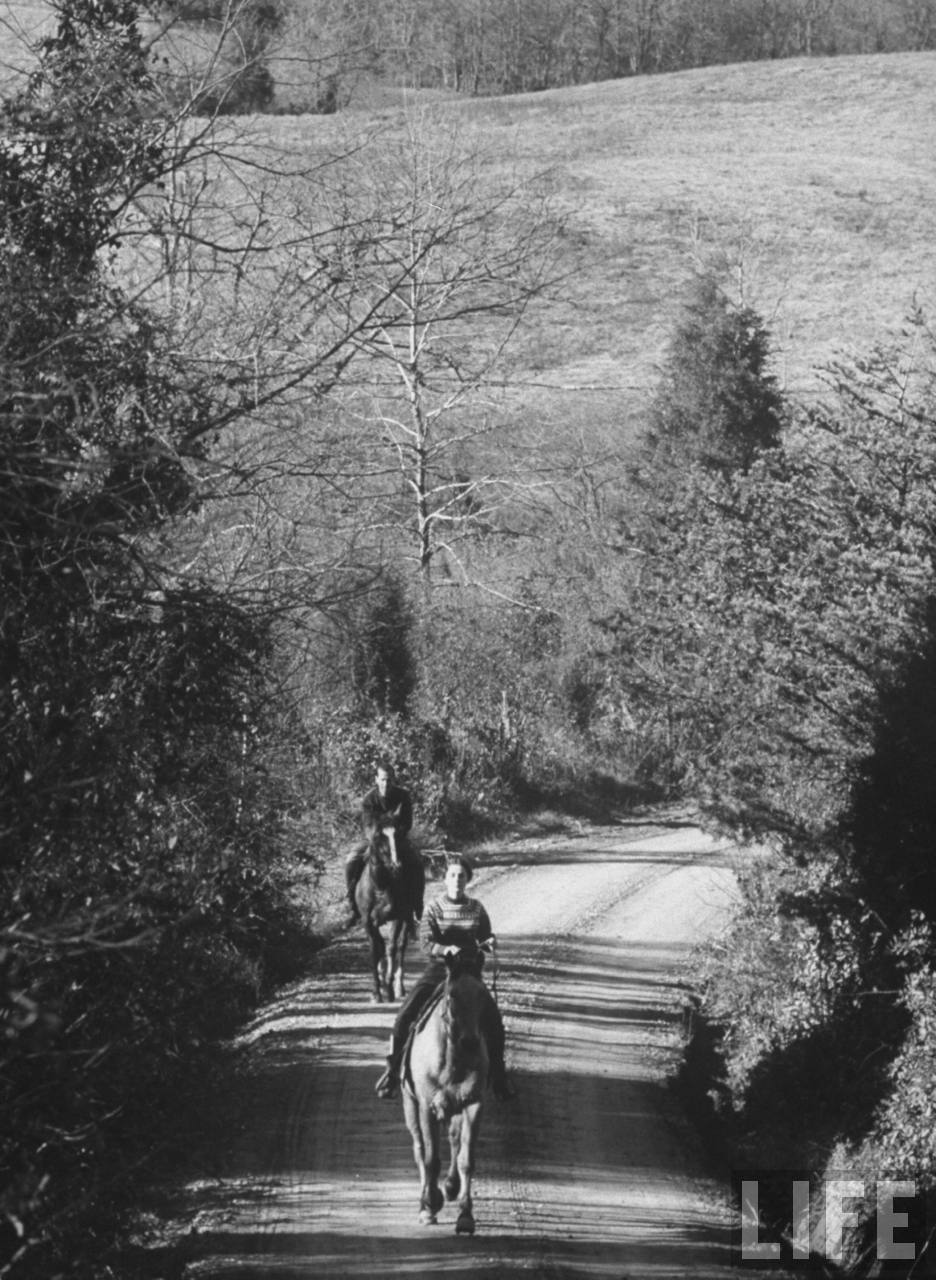 Couple horseback riding. Location:Washington, DC, US Date taken:December 1961 Photographer:Art Rickerby With thanks to adanvc.