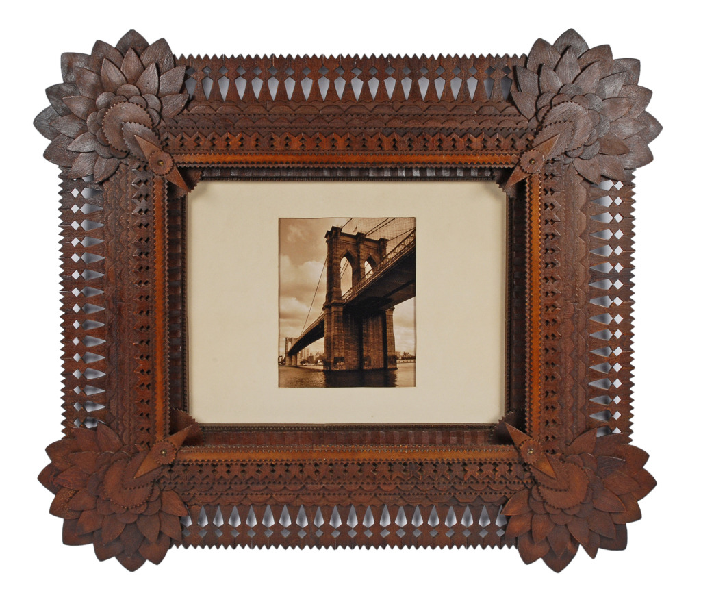 Tramp Art Folk Art Frame 1900 - 1916 Frame made by esteemed tramp artist John Martin Zubersky who lived in Joliet, IL.  His trademark style combines expressive sunflower corners, deeply layered rows with each layer having a different carving style and open tulip carved edges. It was handed down in the family of a neighbor of Zubersky's.The frame dates to 1916 - 1920.