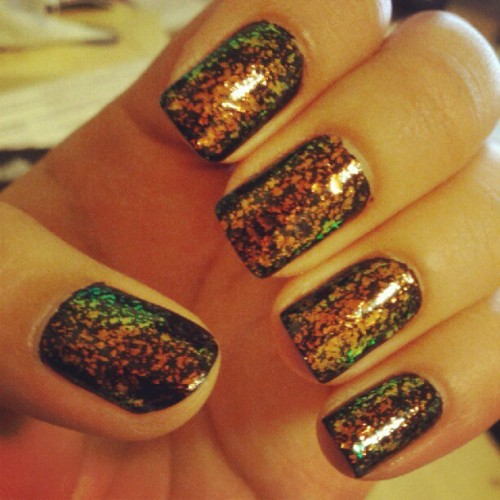 Reminds me of Lisa Frank stickers (Taken with Instagram) Essie-Shine of the times over Black