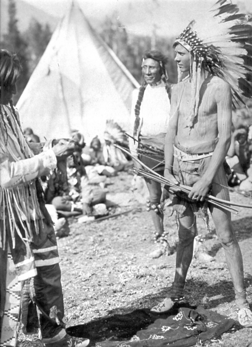 Harry Behn wearing a Blackfoot headdress at Glacier National Park, Summer 1916.