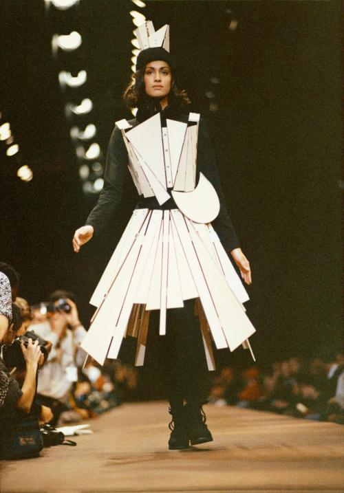 arextav:  Yohji Yamamoto, Autumn-Winter 1991-92, Femme collection  'When I started making clothes, all I wanted was for women to wear men's clothes.'  In the 1990′s Yohji Yamamoto followed one of his other passions – music. He recorded three albums, including Well, I Gotta Go (1991), Your Pain Shall Be Your Music (1994), and Hem: Handful, Empty Mood (1997) and toured Japan. OnYour Pain Shall Be Your Music film director Wim Wenders is asking about our identity and concludes: 'Identity is out of fashion', while actor Richard Bohringer bemoans the church bells that wake him and voice actor Otto Sander suggests to 'throw up and leave'.