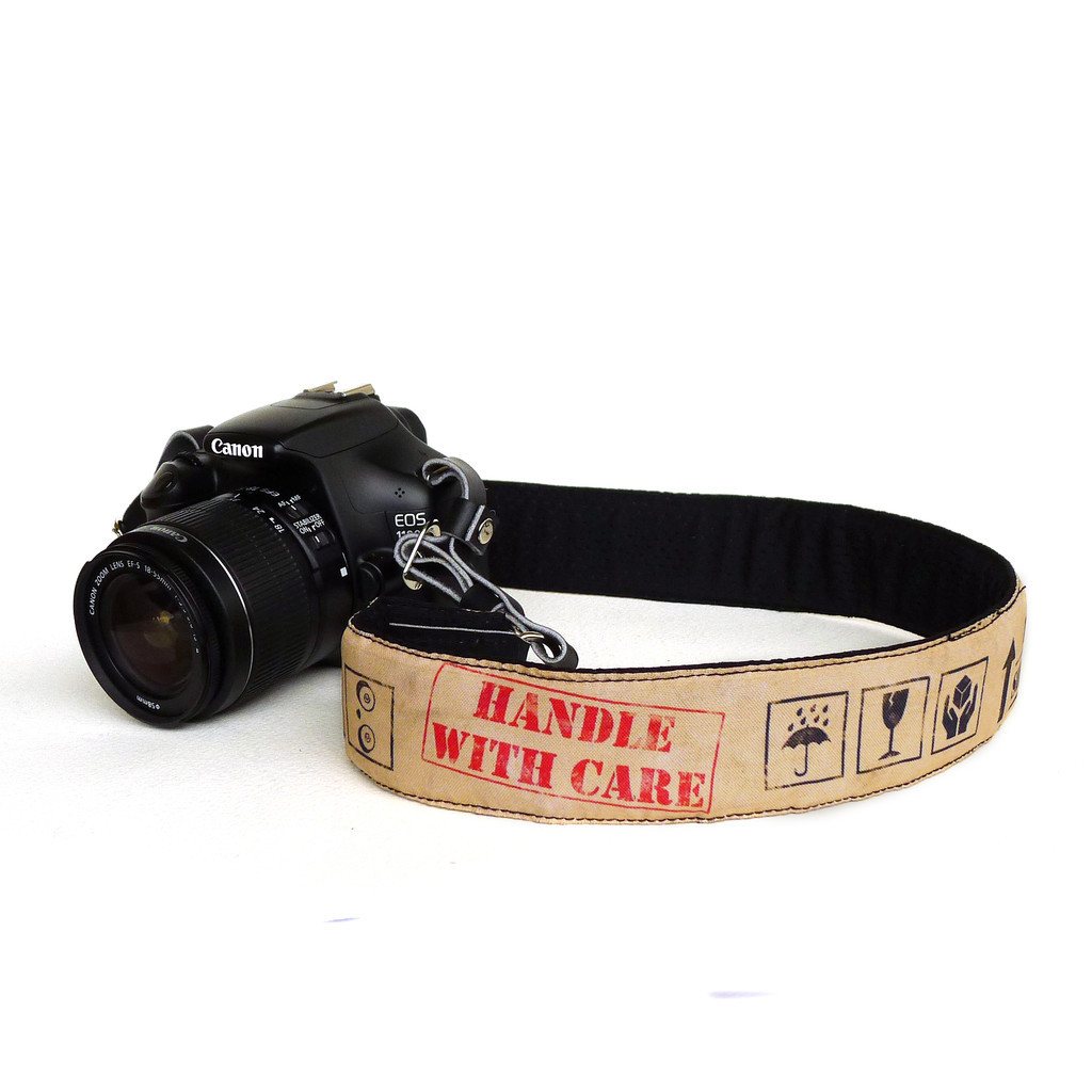 RESTOCKED!Handle With Care camera strap by Jen HornAvailable for SLRs and compact cameras. Get it at La Feria de JunioAyala Triangle, MakatiJune 15, 4-10pmor at www.punchdrunkpanda.com! :)