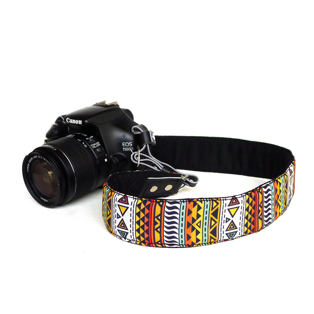 RESTOCKED!Navajo camera strap by Jen HornAvailable for SLRs and compact cameras. Get it at La Feria de JunioAyala Triangle, MakatiJune 15, 4-10pmor at www.punchdrunkpanda.com! :)