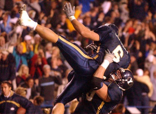 Luke Staley leads the Cougars to glory over Utah in 2001.