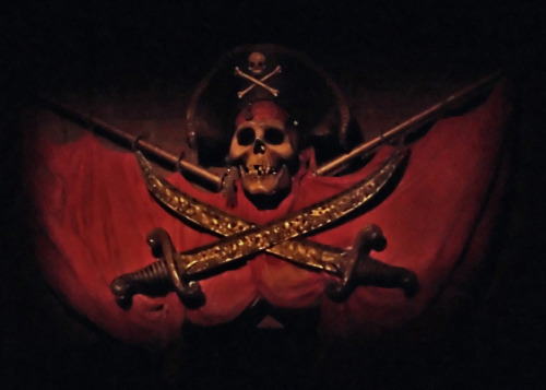"""Psst! Avast there! It be too late to alter course, mateys…and there be plundering pirates lurking in every cove, waitin' to board. Sit closer together, and keep your ruddy hands inboard. That be the best way to repel boarders. And mark well me words, mateys…dead men tell no tales! Ye come seekin' adventure and salty ol' pirates, eh? Sure ye come to the proper place. But keep a weather eye open, mates, and hold on tight, with both hands if you please…there be squalls ahead, and Davy Jones waiting for them what don't obey."""