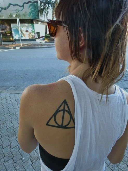fuckyeahtattoos:  This is the deathly hallows symbol from Harry Potter. Not only did I get it because I'm a huge Harry Potter fan but it means protection to me, and that means everything. Got it done by Chris Mack at Eastside tattoo in New Smyrna Beach, FL.