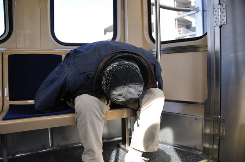 Sleeping on a New CTA Train by vxla on Flickr.