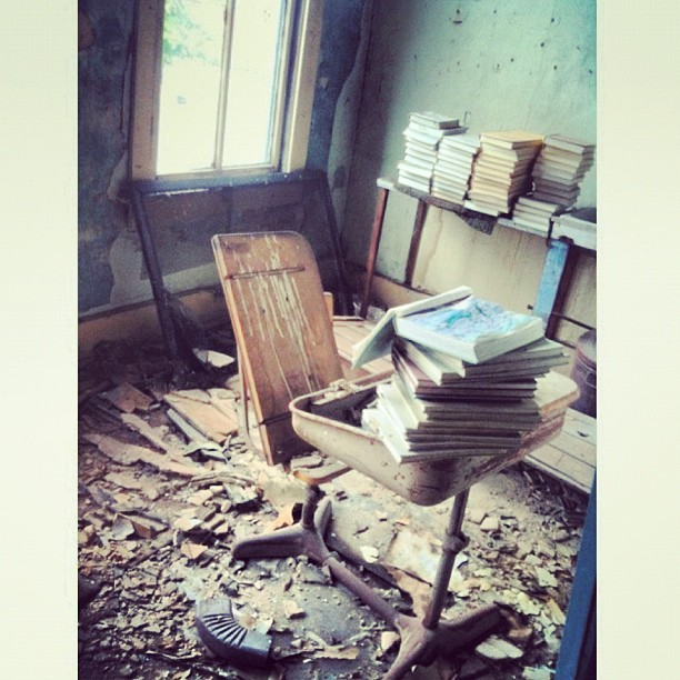 #old #antique #vintage #wood #school #desk #schooldesk #books #stack #stacked #worn #aged #forgotten #grungy #dirty #destruction  (Taken with Instagram)
