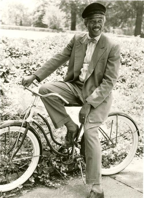 Morgan Freeman relaxes on a bike.
