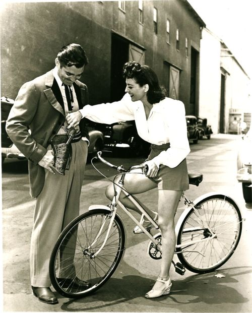 Gun, Girl, Bike, Moustache - perfect.   ridesabike:  Joan Crawford rides a bike. And plays with Clark Gable's gun.