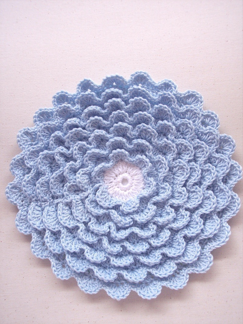 What a lovely example of a Chrysanthemum crochet pattern!  You can find instructions to make your own via SewTakeAHike