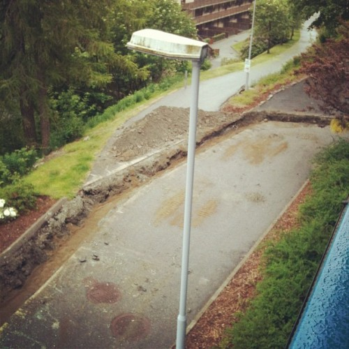 """That's it! We're building a moat."" (Taken with Instagram at Home)  So this is happening.. I don't know, but for some reason someone is digging up our street."