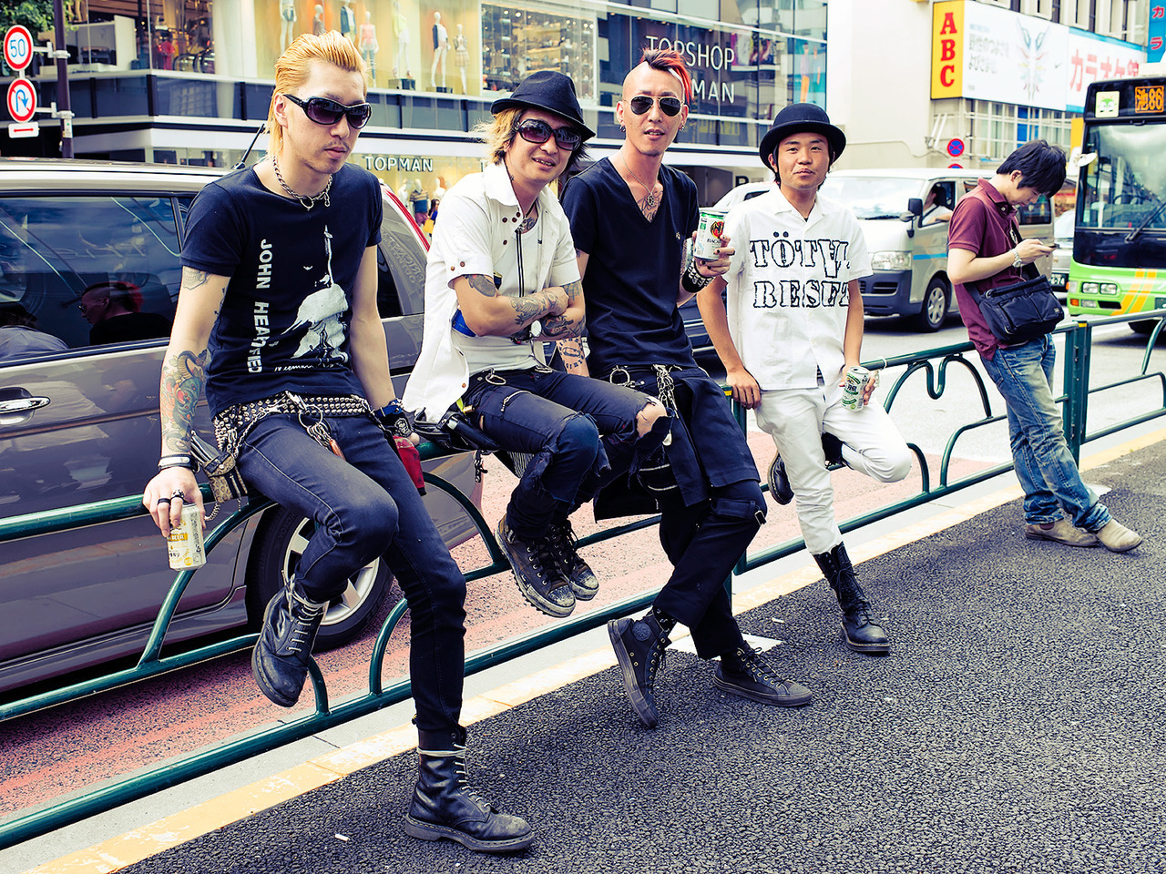Tattooed Japanese punks drinking beer on the street in Harajuku. :-)