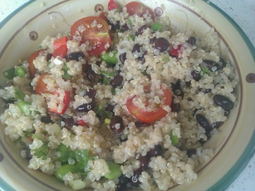 Yesterday I made a Quinoa, black bean, soya bean, tomato and sweet red pepper salad.I just made it up as I went along really, but here's more or less what I used/how I did it:Ingredients1/2 cup quinoa1 cup waterPinch of salt1/2 cup black beans (I used dried beans which I soaked for 8 hours then boiled for 10 minutes, then simmered for 40 mins but you could used tinned beans if you don't have the time)1/4 cup soya beans (I used frozen beans which I microwaved in a bit of water to defrost)4 cherry tomatoes, sliced in half1 small sweet red pepper (or 1/4 normal red bell pepper), diced2 spring onions, sliced.Dressing:1 tbsp Lime juice1 tbsp vegetable oil1 clove garlic (crushed)1 tsp lemon juice1/2 tsp salt1/2 tsp sugarTo serve:1 tbsp fresh coriander, choppedMethod1. Bring the cup of water + pinch of salt to boil in a saucepan2. Add the quinoa, cover the pan and boil for around 10 minutes until the quinoa is more fluffy, you might need to add a bit more water if it starts to dry up too soon. After 10 mins, turn off the heat and leave to stand for 5 minutes. Drain and set aside in a large bowl to cool3. Drain and rinse the cooked or tinned black beans, add to the quinoa4. Add the tomatoes, soya beans, red pepper and spring onions to the mixture5. In a small bowl, combine the dressing ingredients and mix well with a fork. Pour the dressing over the quinoa mix, add the chopped fresh coriander and toss it all together.6. Eat now or refrigerate and eat chilled later (I prefer it chilled!). I still had some left over today, so to change it up a bit I added some sweet chili sauce which was really nice.