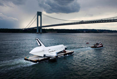 Pictures of the Week: June 8, 2012 – Plog Photo Blog  Space Shuttle Enterprise is carried by barge underneath the Verrazano-Narrows Bridge on June 3, 2012 in New York City. Enterprise is on it's way to the Intrepid Sea, Air and Space Museum, where it will put on permanent display.