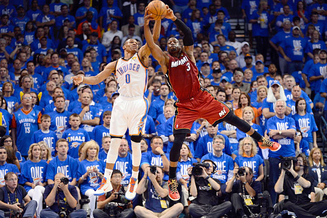 Russell Westbrook and Dwyane Wade battle for a loose ball during Game 1 of the NBA Finals between the Thunder and Heat last night. Oklahoma City prevailed 105-94 to take a 1-0 series lead. Game 2 is on Thursday. (Ronald Martinez/Getty Images) ROSENBERG: Durant, Westbrook keys to Thunder victoryTHOMSEN: Durant outplays LeBron in opening game win