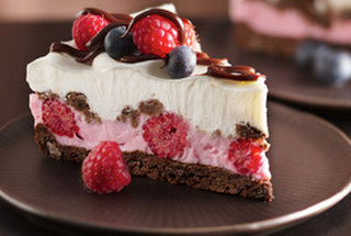 Chocolate and Berries Yoghurt Dessert Recipe Source - http://www.tablespoon.com/recipes/chocolate-and-berries-yogurt-dessert-recipe/2/ Ingredients 1  roll (16.5 oz) Pillsbury® refrigerated chocolate chip cookies 1/4  cup cocoa 1 1/2  cups fresh raspberries 4  containers (4 oz each) Yoplait® Whips!® raspberry mist yogurt 1  cup whipping cream, whipped 2  tablespoons hot fudge topping 1  cup fresh blueberries Directions Heat oven to 350°F. In large bowl, stir or knead cookie dough and cocoa until well blended. On greased cookie sheet, drop dough by tablespoonfuls to make 6 cookies. Bake 8 to 12 minutes or until set. Cool 2 minutes; remove from cookie sheet to cooling rack. Meanwhile, press remaining dough in bottom of 9-inch springform pan. Bake 12 to 15 minutes or until set. Cool completely, about 30 minutes. In medium bowl, fold 1/2 cup of the raspberries into yogurt; spread evenly over crust. Crumble cookies; sprinkle over yogurt mixture. Carefully spread whipped cream over cookie crumbs. Freeze 4 to 5 hours or until firm. Remove sides of pan. Drizzle 1 tablespoon fudge topping over dessert. Top with blueberries and remaining raspberries. Drizzle with remaining 1 tablespoon fudge topping. Store in freezer.